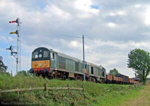 """A pair of English Electric Type 1 diesel locos recreate a scene from the late 1960s, hauling a mixed goods train."" - Photo © Stephen Bottrill."