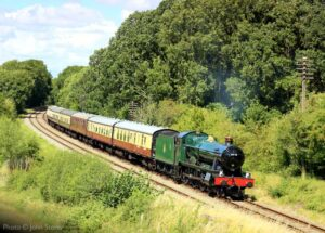 """""""The first day of August brings a Hall and bright sunshine as 6990 'Witherslack Hall' steams south with the 1:50pm passenger train from Quorn & Woodhouse."""" - Photo © John Storer."""