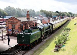 """""""On a bright Leicestershire morning in late July 2020, 9F 92214 'Leicester City' arrives at Quorn & Woodhouse."""" - Photo © Roy Harris."""
