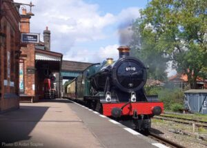 """""""A view from the platform... 6990 'Witherslack Hall' arrives at Quorn & Woodhouse with empty coaching stock to form a passenger train for Leicester North"""". - Photo © Aidan Staples."""