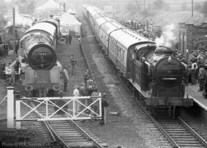 """""""GNR N2 carring LNER number 4744 arrives at Quorn & Woodhouse during a Road Rail Steam event in 1981, while 71000 'Duke of Gloucester' stands in the Up Reception North siding prior to full restoration"""". - Photo © W.R. Squires Collection."""
