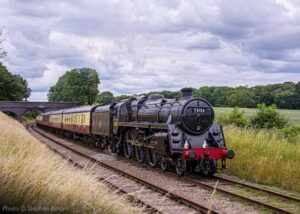 """""""A mid-July afternoon in 2020 on the Great Central sees 73156 working a crew refresher train of empty coaching stock through the countryside"""". - Photo © Stephen Bottrill."""