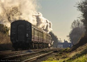 """""""Into the evening... A steam-hauled passenger train approaches Quorn & Woodhouse from the north"""". - Photo © Stephen Bottrill."""