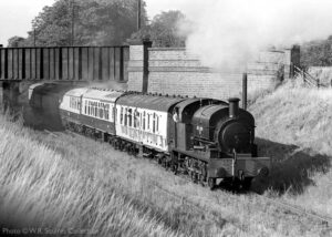 """""""Much earlier in the GCR preservation story in August 1974, Littleton Number 5 passes under the A6 road bridge south of Loughborough, with a train for Quorn & Woodhouse"""". - Photo © W.R. Squires Collection."""