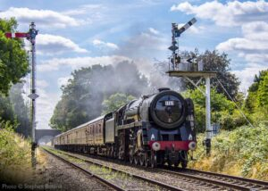"""""""On this day 11th August in 1968, 70013 'Oliver Cromwell' was one of the locomotives chosen to haul the famous 'Fifteen Guinea Special' (1T57) on the last day of steam on the British Railways network..."""" This photograph was taken in 2018 as we recreated 1T57 on the 50th anniversary of the original event. 70013 """"Oliver Cromwell"""" appears courtesy of the National Railway Museum. Photo © Stephen Bottrill."""
