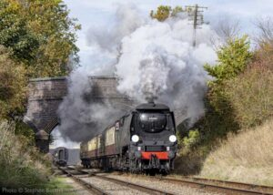 """""""Recreating a busy main line on the Southern Region of British Railways... Visiting Bulleid Light Pacific 34092 'City of Wells' accelerates away from Loughborough Central with a passenger train"""". - Photo © Stephen Bottrill."""