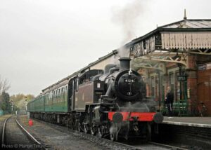 """""""Seen before the restoration of the station canopy, visiting Ivatt Class 2 2-6-2T 41241 stands at Loughborough Central with British Railways Southern Region coaching stock"""". - Photo © Maytyn Tattam."""