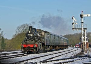 """""""A change of seasons... Ivatt Class 2 46521 works past Swithland Sidings with a passenger train on a winter morning"""". Photo © Stephen Bottrill."""