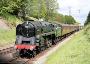 """""""A bright morning on the approach to Rothley, with a 9F hauled passenger train taking centre stage"""". Photo © Roy Harris."""