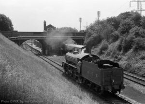 """""""A view into the past... In June 1981, Thompson B1 1306 'Mayflower' runs round a train at Rothley, ready to return to Loughborough Central"""". Photo © W.R. Squires Collection."""