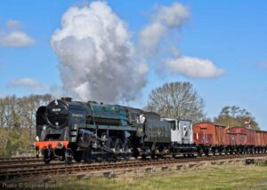 """""""The power of steam... On a sunny morning in Leicestershire, 9F 92214 (running as 92220 'Evening Star') powers past Swithland Sidings with a mixed freight train"""". Photo © Stephen Bottrill."""