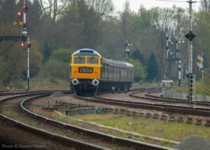 """""""Modern image on the Great Central... Brush Type 4 1705 'Sparrowhawk' hauls a passenger train past Swithland Sidings, with both locomotive and rolling stock carrying liveries seen in the late 1960s"""". Photo © Steven Havers."""
