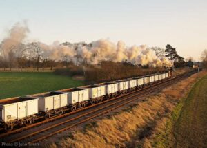 """""""An image of a steam-hauled goods train at sunset... Recreating the experience of a bygone age at the Great Central"""". Photo © John Smith."""