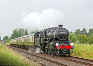 """""""Steaming on with purpose... Visiting Ivatt Class 4 43106 makes smart progress with a southbound passenger train"""". Photo © Syd Hancock."""