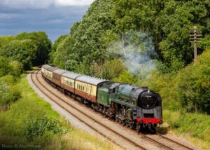 """""""A 9F finds light work on an afternoon passenger train, north of Swithland Reservoir on the Great Central"""". Photo © Alan Weaver."""