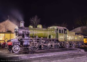 """""""Evening on shed... Ivatt Class 2 46521 rests after a busy day of work, earlier this year"""". Photo © Stephen Bottrill."""