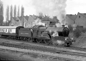 """""""During Easter 1983, GCR Improved Director Class 506 'Butler Henderson' departs from Loughborough Central towards Quorn & Woodhouse"""" The coach immediately behind the loco is Mark 1 BSK E34393 which remains in regular service at the GCR. 506 """"Butler Henderson"""" is owned by the National Railway Museum. Photo © Harper Shaw Collection."""
