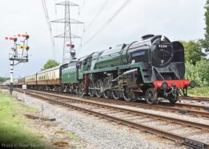 """""""The commanding presence of a 9F... 92214 'Leicester City' passes Swithland Sidings with a train for Leicester North"""". Photo © Peter Salmon."""