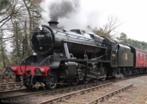 """""""Stanier Class 8 48305 approaches Rothley with a local passenger train"""". Photo © Roy Harris."""
