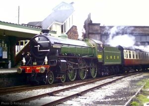 """""""Looking back to the early 1980s, Thompson B1 1306 'Mayflower' arrives at Quorn & Woodhouse"""". Photo © Richard Bingham,"""