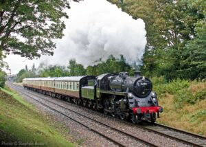 """""""Visiting British Railways Standard Class 4 2-6-0 76084 steams through the cutting south of Loughborough Central on a damp day in 2014"""". - Photo © Stephen Bottrill."""