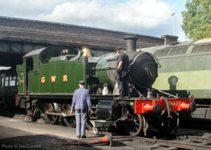 """""""Guidance from a voice of experience... GWR Small Prairie 5542 receives attention on shed at Loughborough back in 2011."""" - Photo © Joe Connell"""