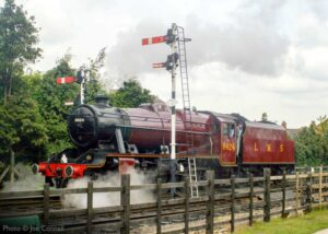 """""""Back in 2011, Stanier Class 8 8624 appeared in an LMS Crimson Lake livery for a time. The popular loco is seen here at Loughborough Central."""" - Photo © Joe Connell."""