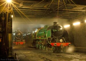 """""""Lights shine brightly outside Loughborough Locomotive Works. Southern Railway King Arthur Class 777 'Sir Lamiel' stands with Stanier Class 8 48624 after a busy day of work."""" 777 'Sir Lamiel' appears courtesy of the National Railway Museum. - Photo © Stephen Bottrill."""
