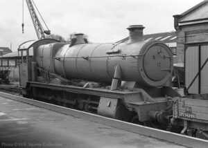 """""""Looking back to 1975, 6990 'Witherslack Hall' stands without tender at Loughborough Central prior to restoration.""""- Photo © W.R. Squires Collection."""