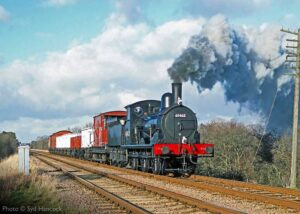 """""""An Eastern Region goods train makes its way along a busy main line... Visiting J15 65462 is pictured just south of Quorn & Woodhouse back in 2004."""" - Photo © Syd Hancock."""