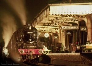 """""""Night time steam... Stanier Class 5 45305 stands in Platform 2 at Loughborough Central, prior to the full restoration of the station canopy."""" - Photo © Andy Bennett."""