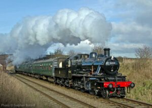 """""""An afternoon local train makes its way through the Leicestershire countryside, with Ivatt Class 2 46521 in charge."""" - Photo © Stephen Bottrill."""