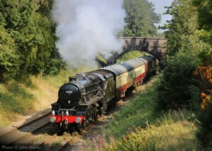 """""""Making smart progress, Stanier Class 5 45305 'Alderman A.E. Draper' steams towards Quorn & Woodhouse with empty coaching stock for the next timetabled service."""" - Photo © John Storer."""