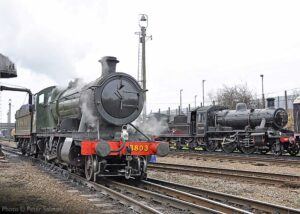 """""""Locomotive variety at Loughborough Central... GWR 2-8-0 3803 takes water in preparation for the next trip. British Railways Standard Class 2 78019 is in the background."""" - Photo © Peter Salmon."""