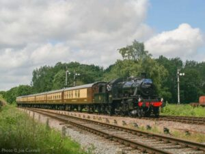 """""""A view from June 2011. Ivatt Class 2 46521 hauls the lunchtime dining train past Swithland Sidings"""". - Photo © Joe Connell."""