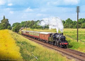 """""""A picturesque scene, with steam on a summer day at the Great Central, with Ivatt Class 2 46521."""" - Photo © Alan Weaver."""