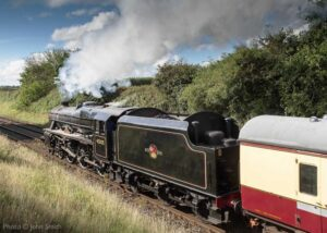 """""""A journey by steam train awaits passengers at the next station, as Stanier Class 5 45305 hauls empty coaching stock through the Leicestershire countryside."""" Photo © John Smith."""