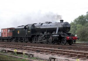 """""""A mineral train trundles past Swithland Sidings, with Stanier Class 8 48305 in charge.""""</strong><br /> Photo © Roy Harris."""