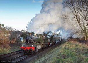 """""""Western morning... Visiting GWR Manor Class 7802 'Bradley Manor' pilots 6990 'Witherslack Hall', working a passenger train for Leicester North."""" - Photo © John Smith."""