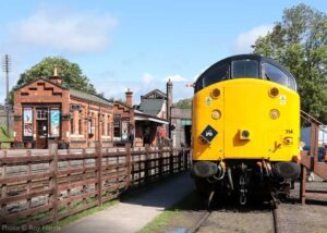 """""""A meeting of the eras... British Rail Class 37 37714 stands on display, as it would have appeared in the 1990s, while Quorn & Woodhouse Station is presented during the 1940s wartime era."""" - Photo © Roy Harris."""