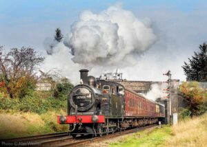 """""""Bright sunshine greets popular Fowler 3F 47406, making a determined departure from Loughborough Central with a local passenger train."""" - Photo © Alan Weaver."""