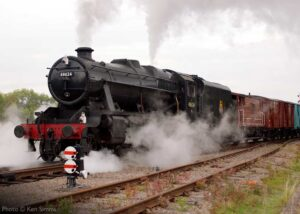 """""""Steam at work... A goods train is hauled out of the sidings to begin its journey, with Stanier Class 8 48624 in charge."""" - Photo © Ken Simms."""