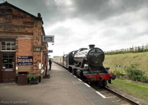 """""""An afternoon arrival... Stanier Class 8 48305 arrives at Quorn & Woodhouse with a passenger train in September 2020."""" - Photo © John Smith."""