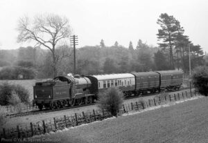 """""""GCR Improved Director Class 506 'Butler Henderson' coasts towards Loughborough Central on 8th May 1982."""" 506 """"Butler Henderson"""" is owned by the National Railway Museum. - Photo © W.R. Squires Collection."""