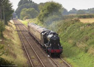 """""""Having crossed the newly replaced deck of Bridge 341 and the original Bridge 340, Stanier Class 8 48305 continues towards Loughborough Central."""" - Photo © John Smith."""
