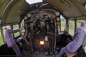 """""""A view from the footplate as Driver and Fireman observe the road ahead."""" - Photo © Stephen Bottrill."""