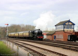 """""""The South Yorkshireman hurries past Swithland Sidings, hauled by Stanier Class 5 45305."""" - Photo © John Storer."""