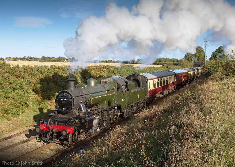"""""""In the morning sunshine, Ivatt Class 2 46521 makes the journey to Quorn & Woodhouse with empty coaching stock for the next passenger train."""" - Photo © John Smith."""