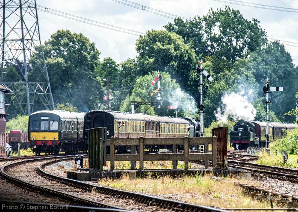 """""""A scene of a busy main line at Swithland Sidings as two trains pass, while a diesel railcar waits in the loop."""" - Photo © Stephen Bottrill."""