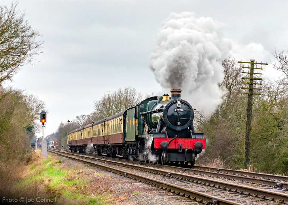 """""""A Hall in full flight... 6990 'Witherslack Hall' accelerates away from Quorn & Woodhouse with a southbound passenger train."""" - Photo © Joe Connell."""